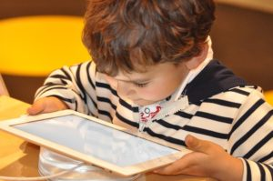 child reading on an iPad